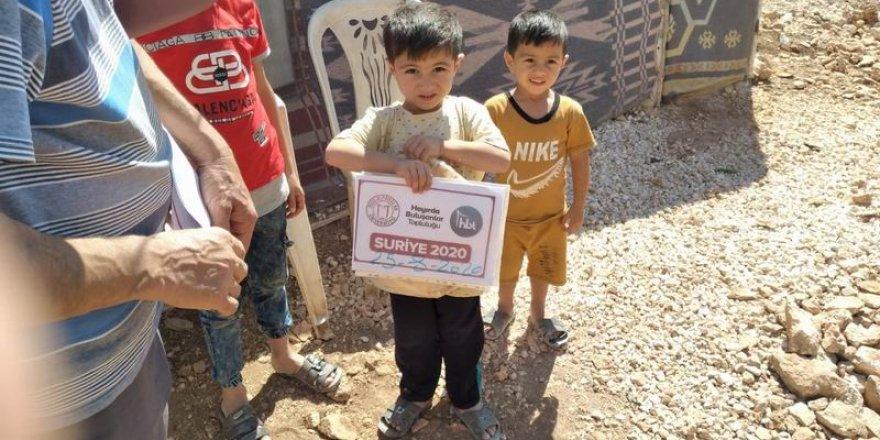 HBT gönüllüleri ekmeklerini Suriyeli mazlumlarla paylaşıyor