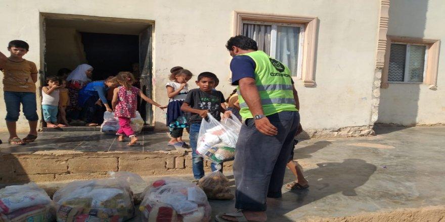 Özgür-Der'den İdlib'deki yetim ve şehit ailelerine gıda yardımı