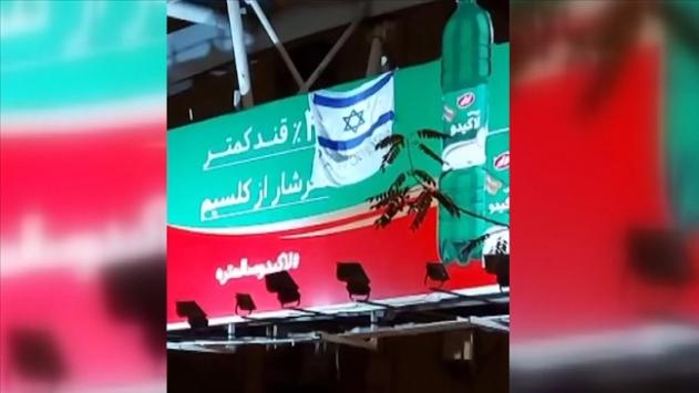 İran'da bir üst geçide İsrail bayrağı ile 'teşekkürler Mossad' yazısı asıldı