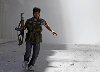 Direnişçiler Halepte 2 TIR Silah Ele Geçirdi