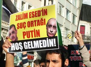 Esed'in İşbirlikçisi Putin Protesto Edildi