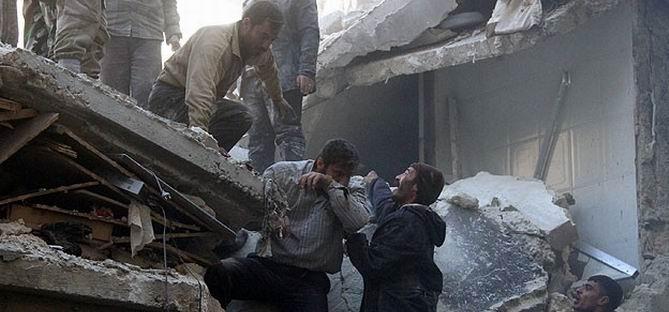 Esed Güçlerinden Halep'e Hava Saldırısı