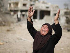 Siyonistlerin Boşalttığı Huzaa'da Katliam Manzarası