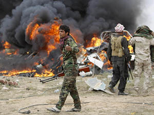 'Şii Milisler Tikrit'te Sivillere Ait Evleri Yakıyor'