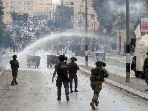 Batı Şeria'da 14 Filistinli Yaralandı