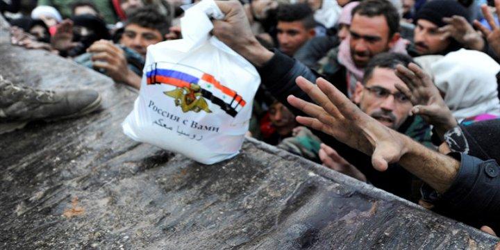 Katliamcı Rusya'dan Halepli Kurbanlarına Yardım Şovu!