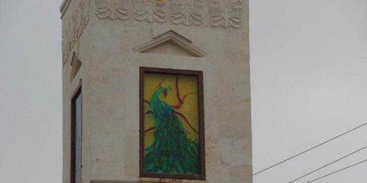 DBP'li Belediyenin 'Êzidilik'i Simgeleyen Saat Kulesi Tepki Çekti