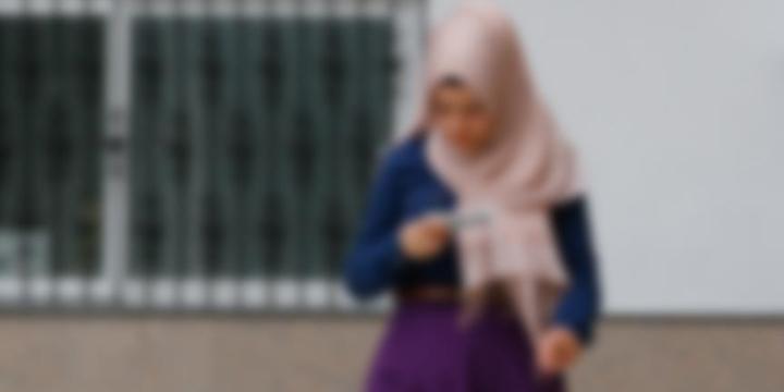 Başörtülü Genç Kıza Saldıran Kadın Tutuklandı