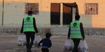 Özgür-Der Suriye'de kumanya ve kömür dağıttı