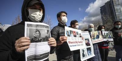 Çin'i protesto eden Doğu Türkistanlılara ev hapsi!