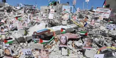 Siyonist İsrail saldırılarında ölen çocukların fotoğrafları enkazda sergilendi
