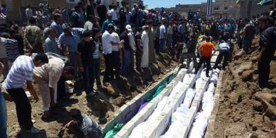 SMDK, rejimin Humus'ta 5 bin 210 sivil katlettiğini ispatlayan belgeleri paylaştı