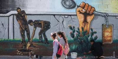 Gazze'de ressamlar hapisten kaçan Filistinlileri resmetti