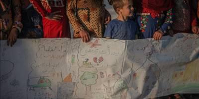 İdlib'de kamplardaki çocuklar, sıcak yuva özlemlerini 75 metrelik mesajla aktardı