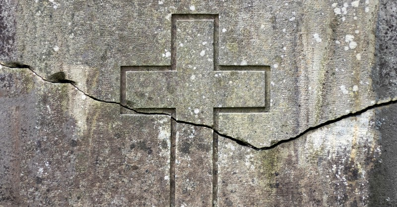 8838-crack-through-cross-etched-on-stone-gettyimag.jpg