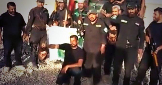 caferiler-esirlerin-basini-kesip-top-oynadi-asaibul-hak-sii-militanlar-irak-+18.jpg