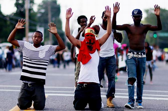 ferguson-hands-up-dont-shoot-protests-2014-nillboard-650.jpg