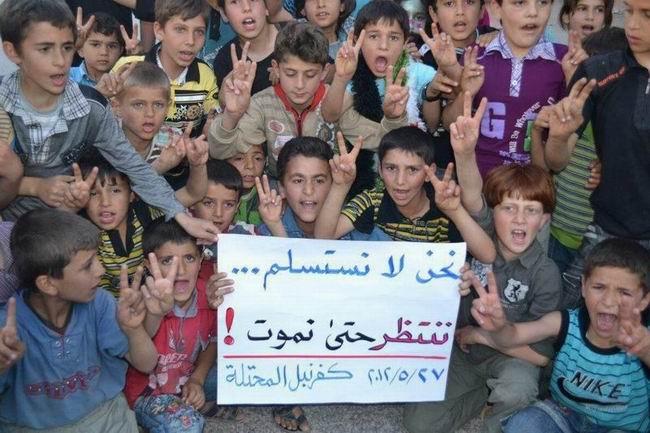 suriyeli-cocuklar_biz-olene-kadar-teslim-olmayiz_kafranbel-idlip.jpg